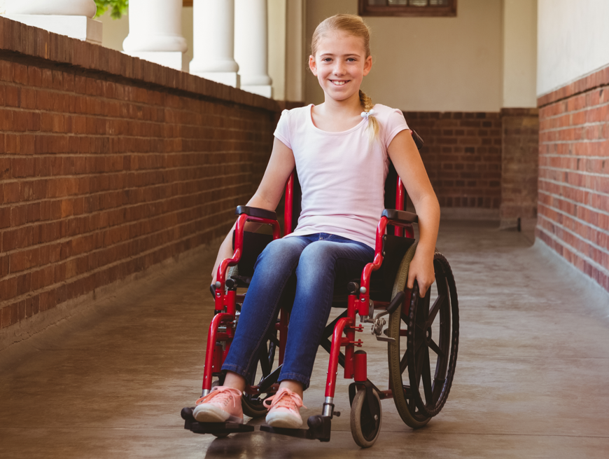 Young girl in red wheelchair