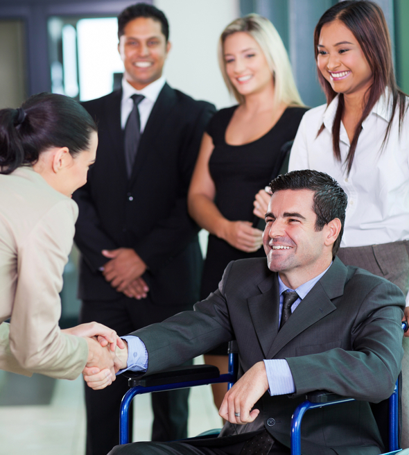 Business man in a wheelchair shaking a ladies hand