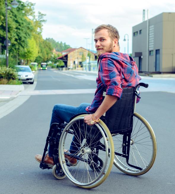 Man in wheelchair crossing street